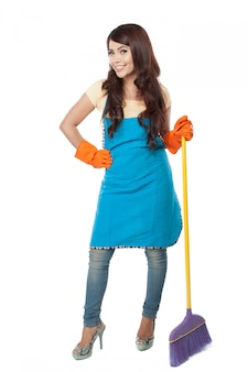 Beautiful young asian woman posing hold onto a broom