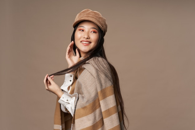 Beautiful young asian woman posing in stylish clothes
