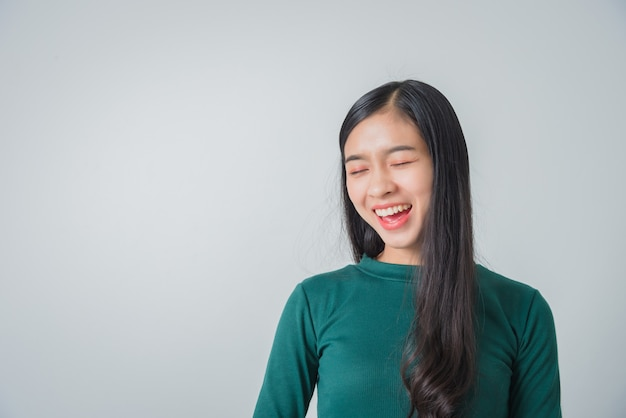Beautiful young asian woman smiling and looking happily and laughing