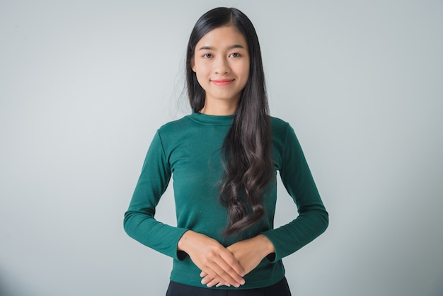Beautiful young asian woman smiling and looking happily