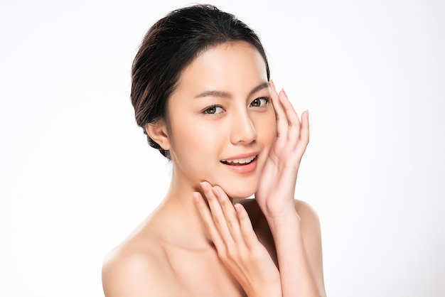 Beautiful young asian woman touching soft cheek and smile with clean and fresh skin. happiness and cheerful with, isolated on white , beauty and cosmetics , Premium Photo