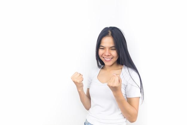Beautiful young asian woman on white background celebrating