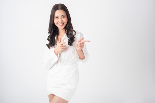 Beautiful young  asian woman on white dress
