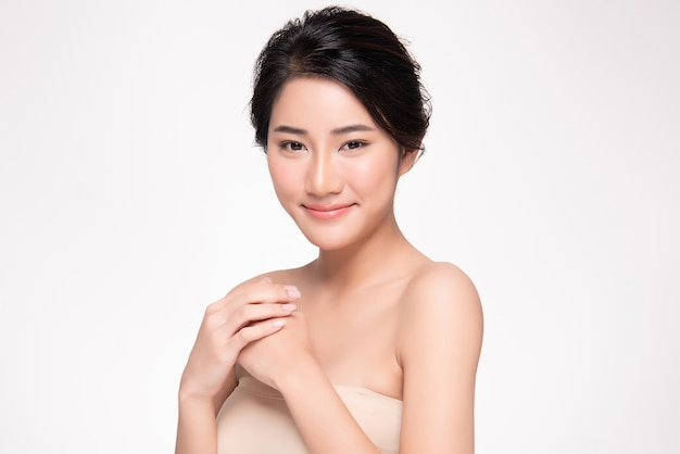 Beautiful young asian woman with clean and fresh skin happiness and cheerful