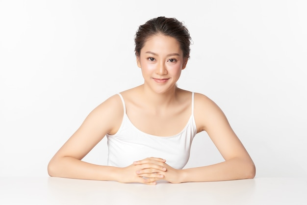 Beautiful young asian woman with clean fresh skin, on pink background, face care, facial treatment. cosmetology, beauty and spa. asian women portrait