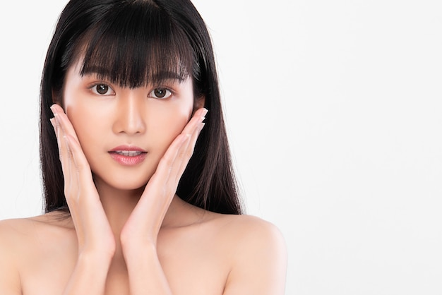 Beautiful young asian woman with clean fresh skin, on white wall, face care, facial treatment, cosmetology, beauty and spa, asian women portrait