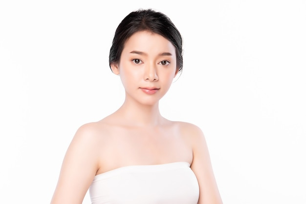 Beautiful young asian woman with clean fresh skin on white wall, face care, facial treatment, cosmetology, beauty and spa, asian women portrait.