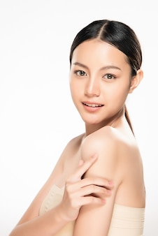 Beautiful young asian woman with clean fresh skin