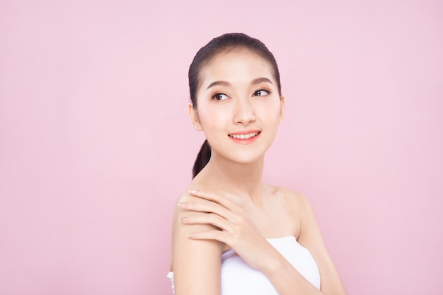 Beautiful young asian woman with clean fresh white skin face in beauty pose.
