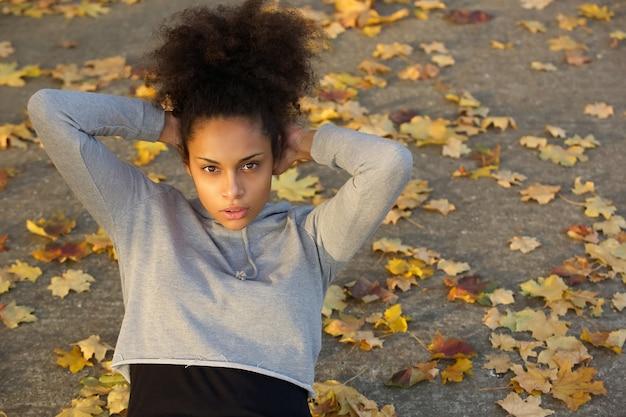 Beautiful young black woman doing sit ups