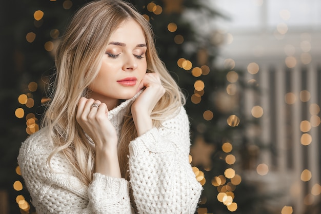 Beautiful young blond woman on christmas