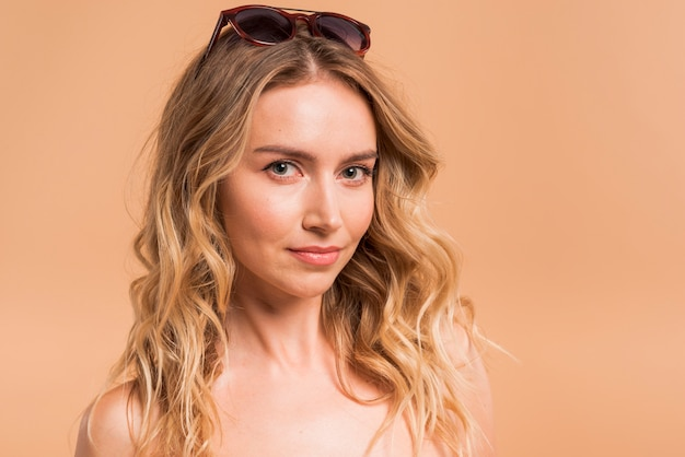 Beautiful young blond woman in sunglasses