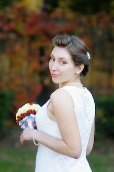 Beautiful young bride portrait outdoors
