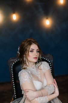 Beautiful young bride in a white lingerie. last preparations for the wedding waiting for the groom.