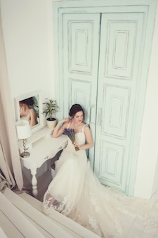 Beautiful young bride in white wedding dress