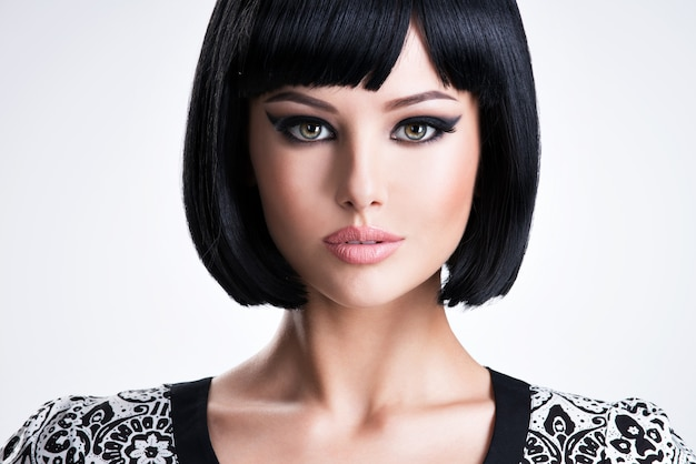 Beautiful young brunette woman with short hairstyle