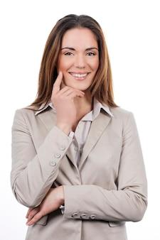 Bella giovane donna d'affari in posa isolato su bianco