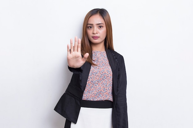 Beautiful young business woman with open hand doing stop sign with serious expression