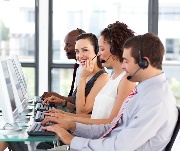 Beautiful young businesswoman in a call center