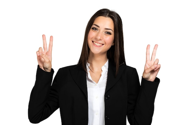 Beautiful young businesswoman portrait, making the victory sign