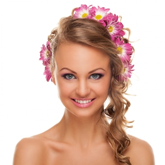 Beautiful young caucasian woman with flowers