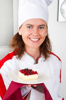 Beautiful young chef with dessert