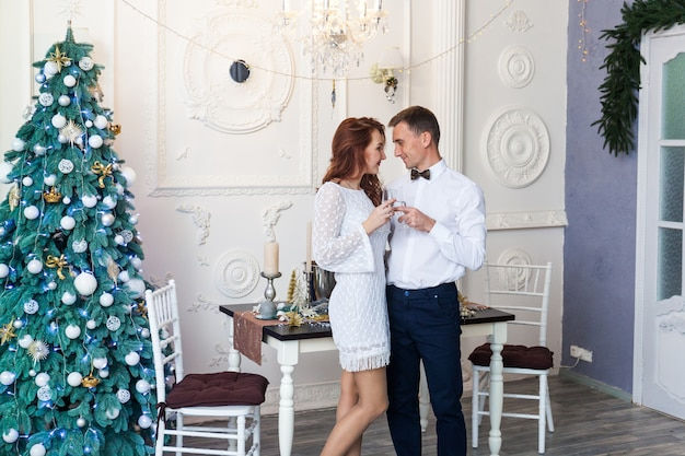 Beautiful young couple celebrating christmas at home