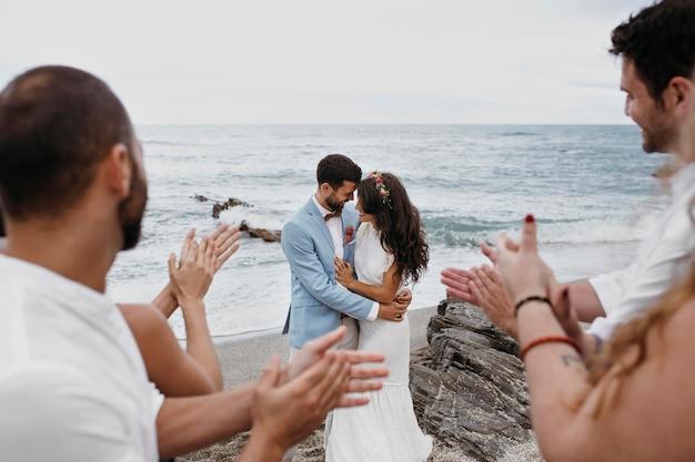 Beautiful young couple having a beach wedding