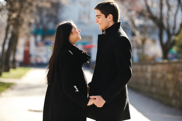Beautiful young couple meets in the city
