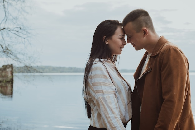 Beautiful young couple near a river