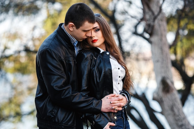 Beautiful young couple posing in the park