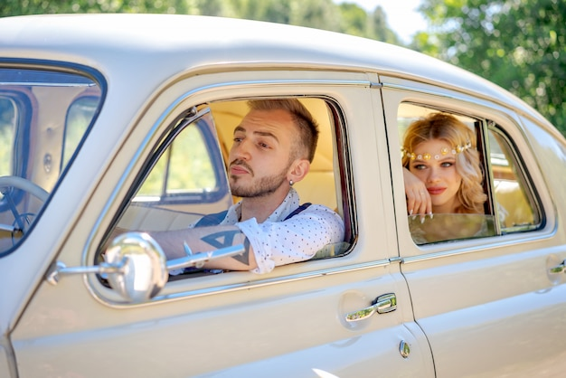 Beautiful young couple sitting in car romantic relationship