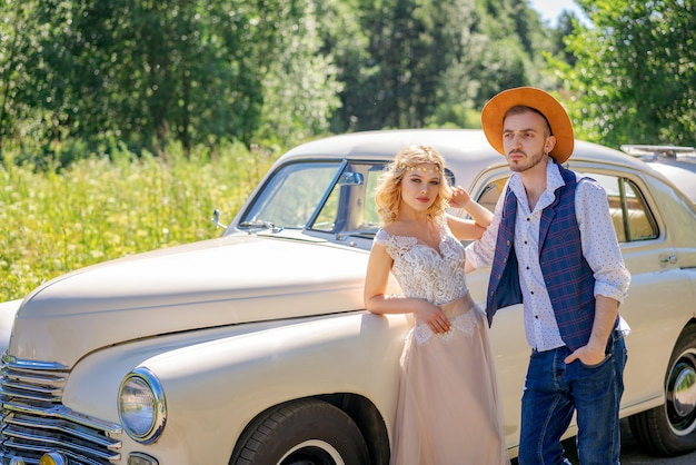Beautiful young couple standing by the car