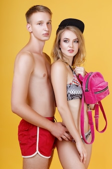 Beautiful young couple in summer clothes posing