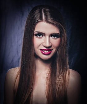 Beautiful young female model posing in front of camera.