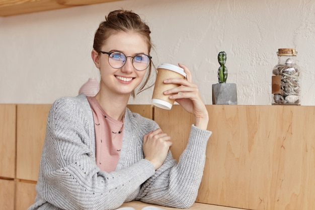 Beautiful young female with cup of coffee