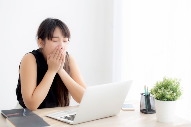 Beautiful young freelance asian woman working bored and tired on laptop computer