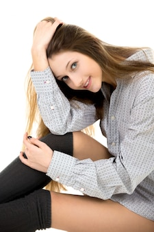 Beautiful young girl in cozy clothes