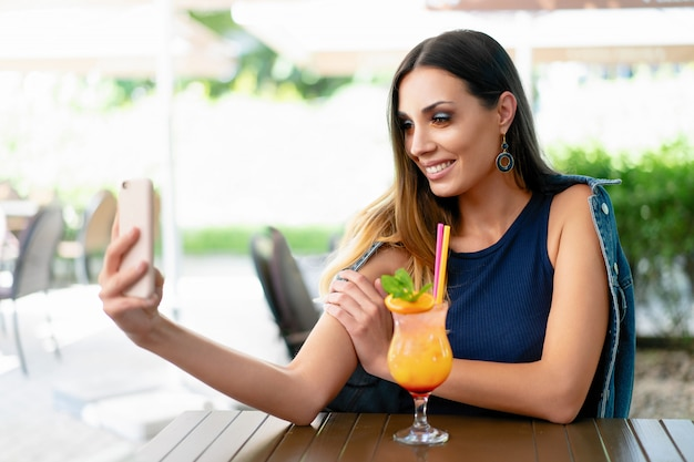 A beautiful young girl drinking an exotic summer cocktail