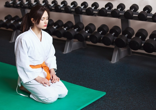 Beautiful young girl in a kimono arts karate sports lifestyle fitness healthy