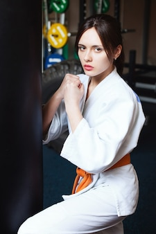 Beautiful young girl in a kimono the concept of karate sports lifestyle fitness healthy