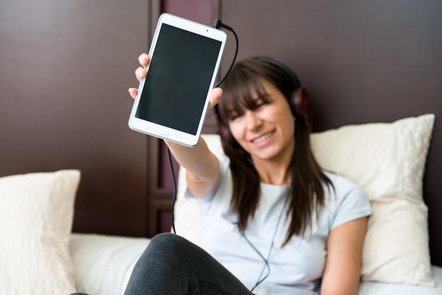 Beautiful young girl listening music