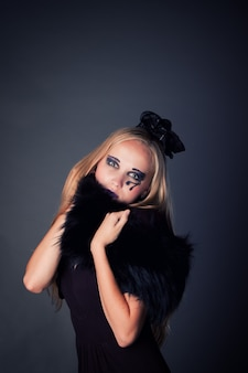 Beautiful young girl make up as a witch