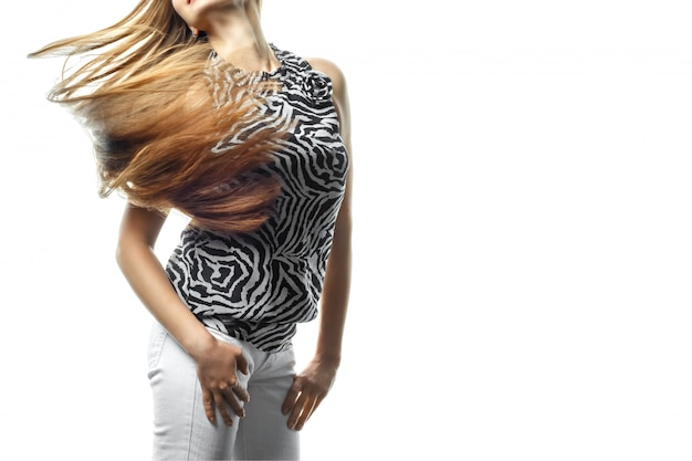 Beautiful young girl in move with a perfectly smooth hair on white.