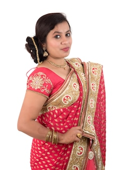 Beautiful young girl posing in indian traditional saree on white.