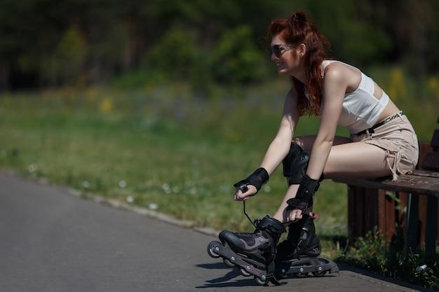 Beautiful young girl roller skating