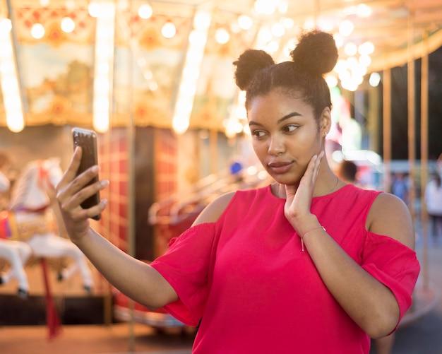 Beautiful young girl taking a selfie