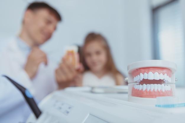Beautiful young girl visiting dentist