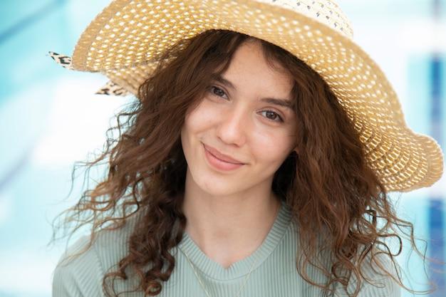 A beautiful young girl wearing a hat