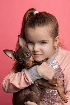 Beautiful young girl with cute terrier dog